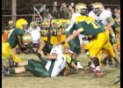 Cobra fullback Adam Brey (shown above, second from left) puts his shoulder down and tries to charge forward for a few extra yards in Friday's playoff game at Olpe. While Brey and his fellow running backs racked up the yards, Heights could not translate that into points, ultimately bringing an end to the Cobras' 8-2 season.