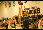 Jackson Heights senior Hannah Williams (22 in the green jersey)  goes up for a shot in the paint against the Lady Dragons of Valley Falls on Tuesday, Jan. 3 in the 42-19 loss.