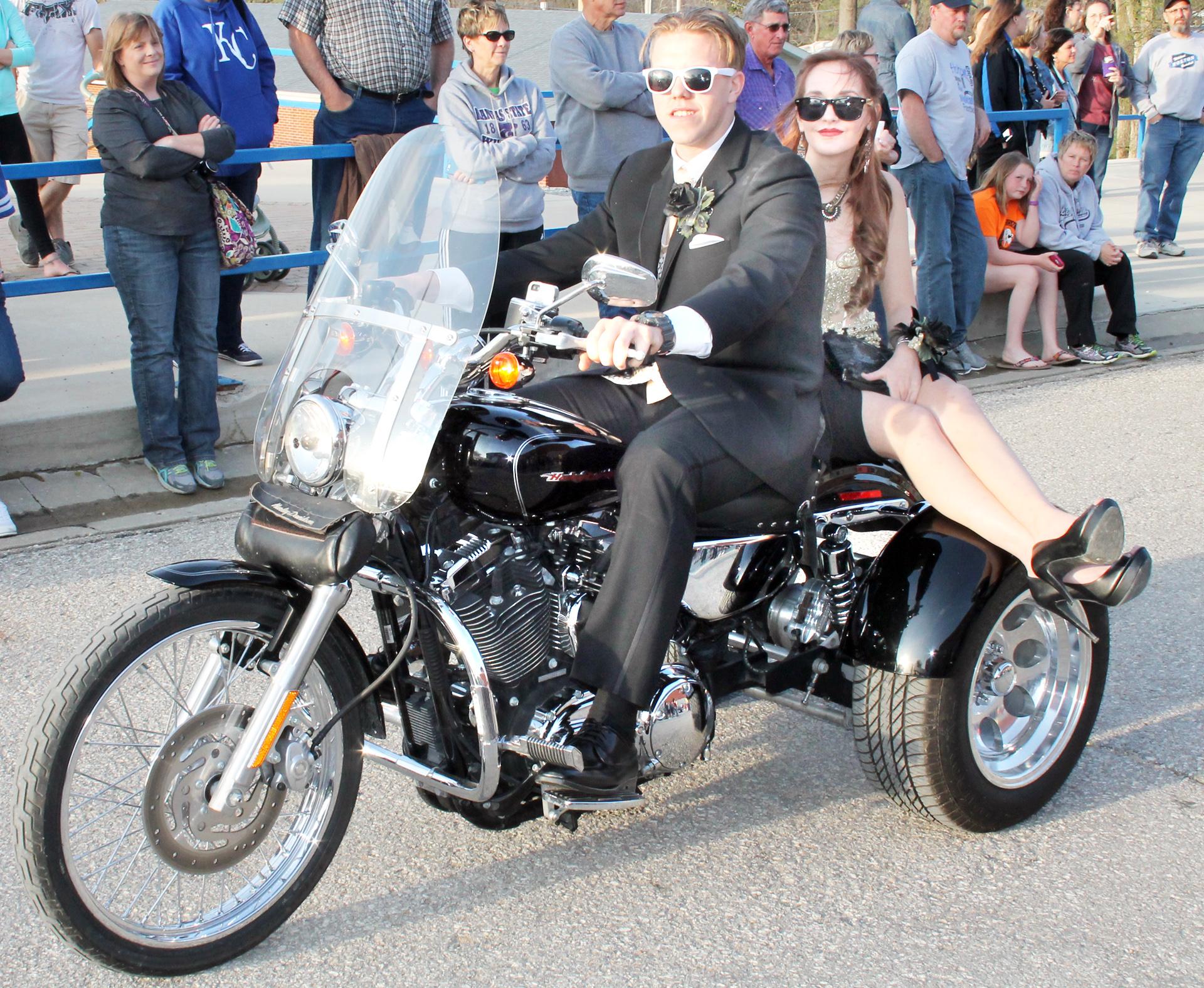 "Brandon Lehnherr (left) drove Sophia Mellenbruch to the prom on a Harley-Davidson ""trike."" (Photo by Brian Sanders)"