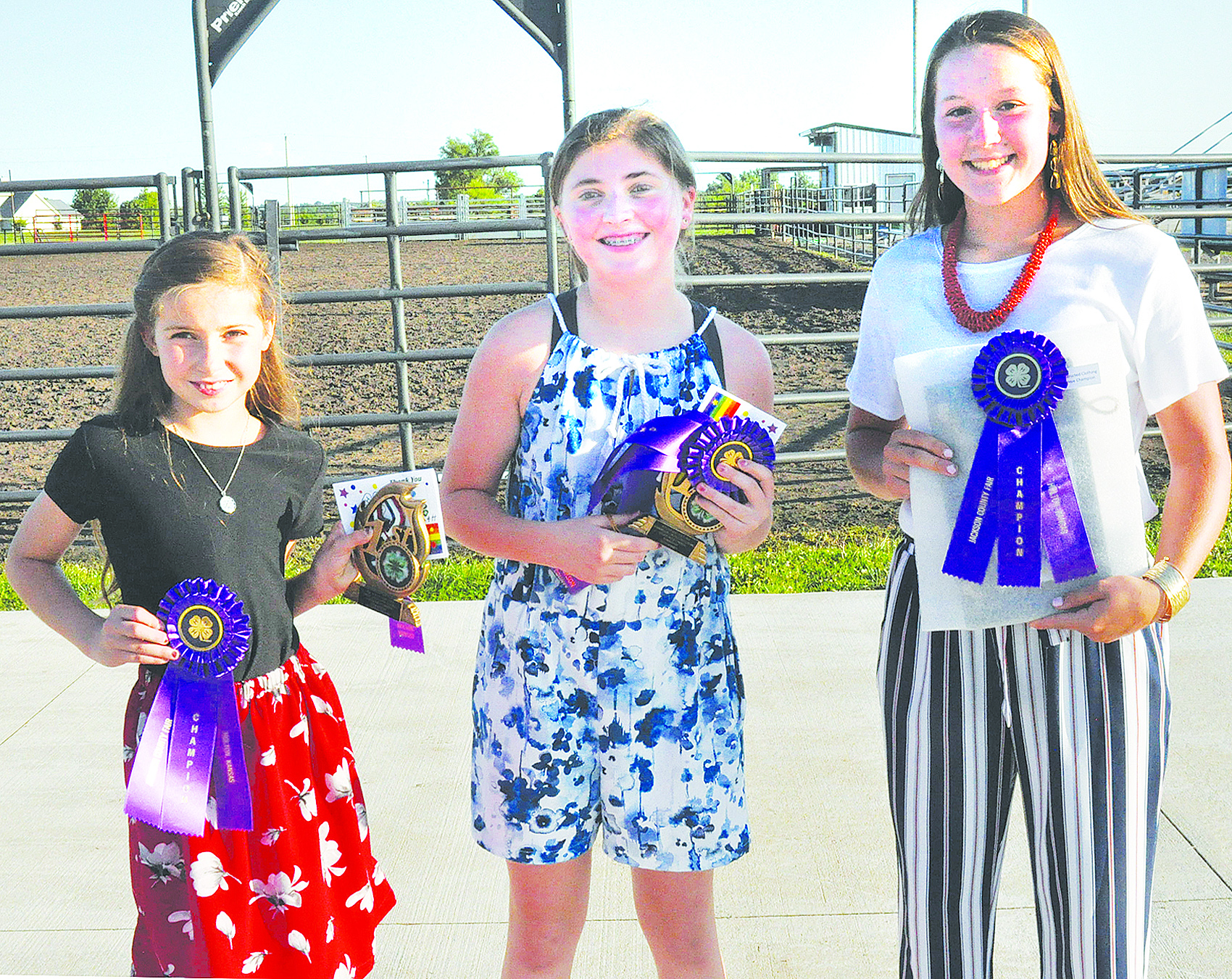 Constructed garment champions at the Jackson County 4-H Fashion Revue are shown above and include (from left) Alaina Bausch (junior champion), Kennedy Smith (intermediate champion) and Karlie Albright (senior champion). (Photo by Ali Holcomb)