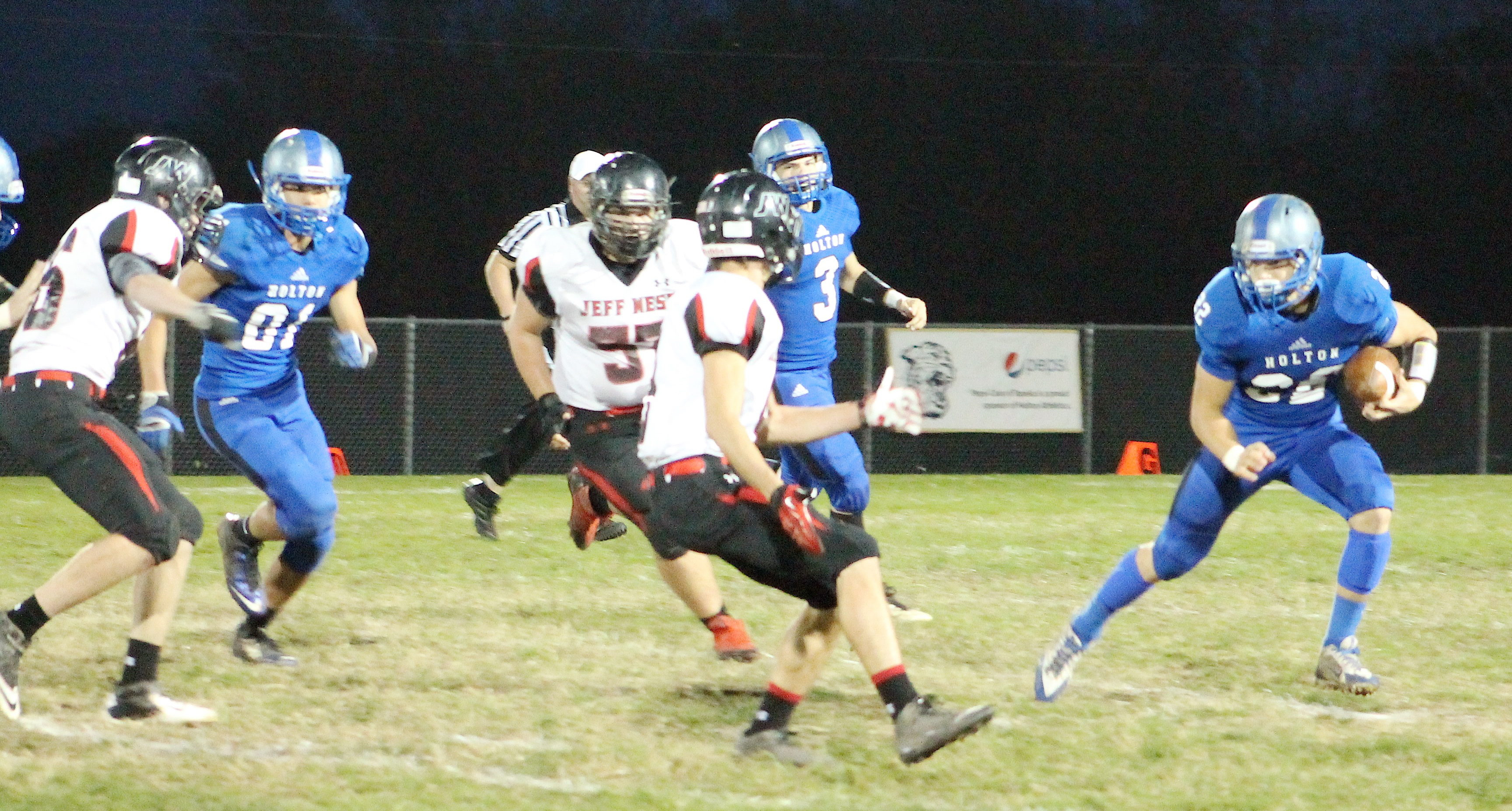 Indie Allen (right) tries to cut to the outside for more running room early in Friday's game.