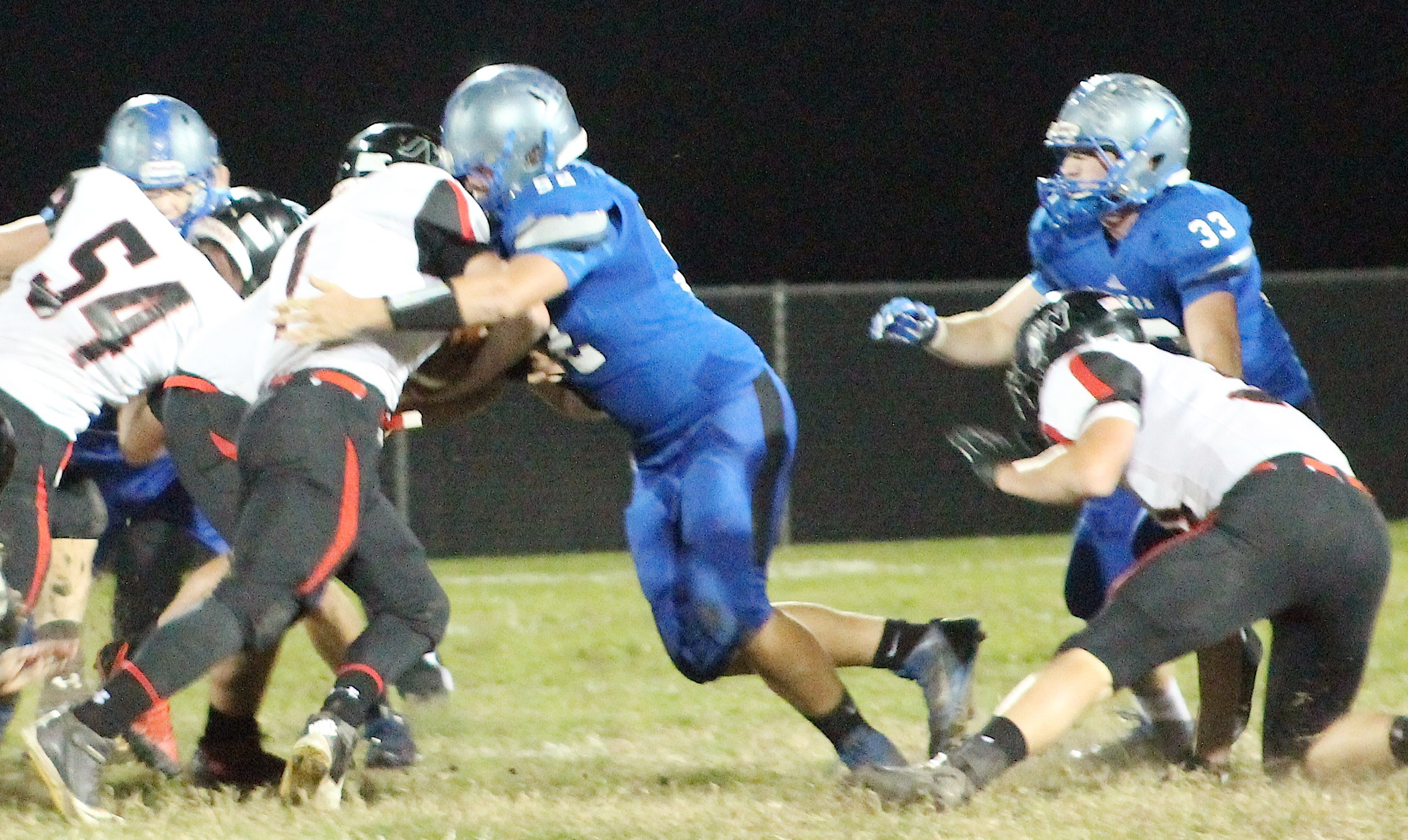 Holton lineman Jacob Coufal (middle) holds his ground at the line of scrimmage.