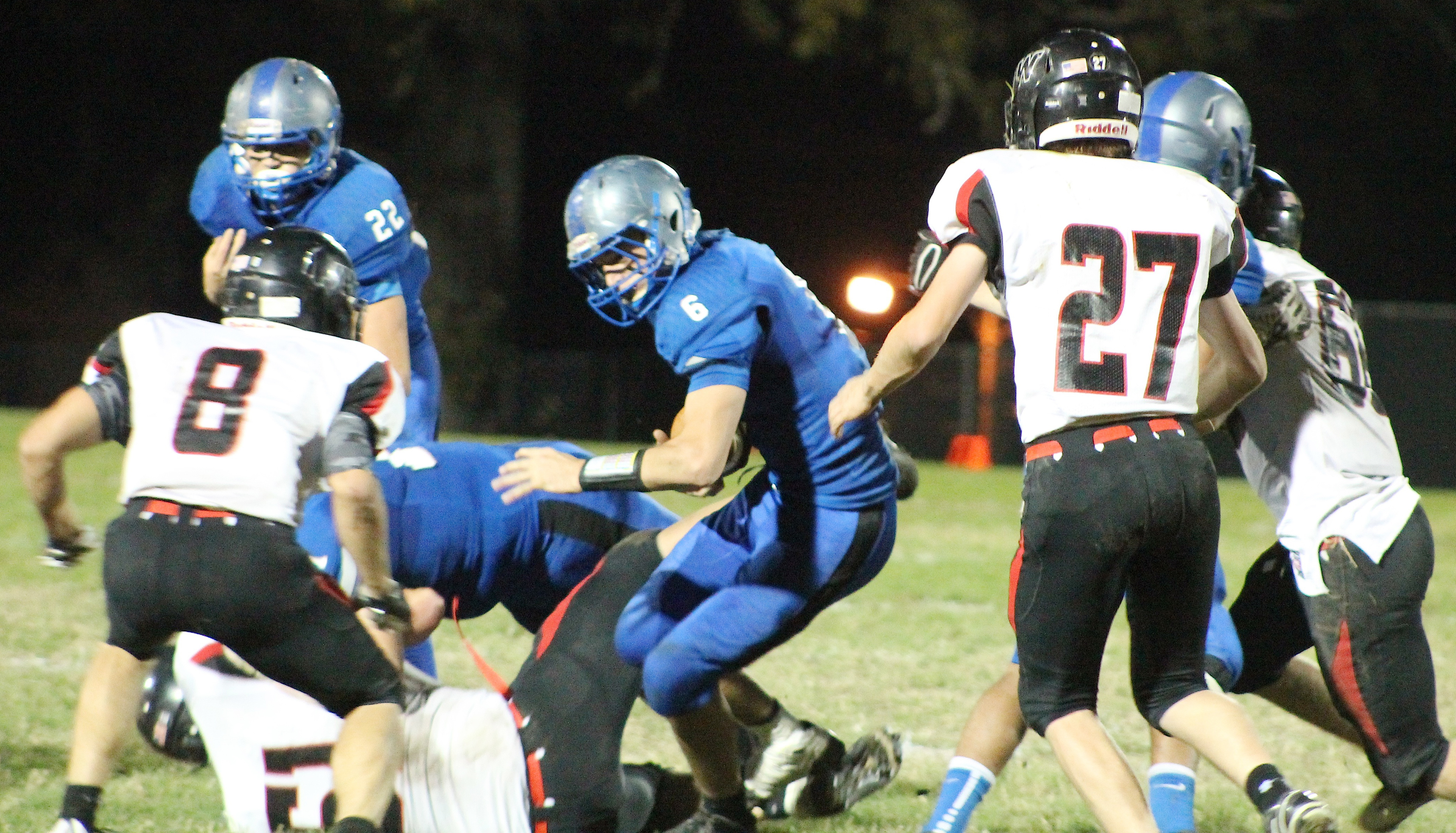 Holton's Lucas Lovvorn (middle) tries to spin free for some extra yards during first half action against Jeff West.