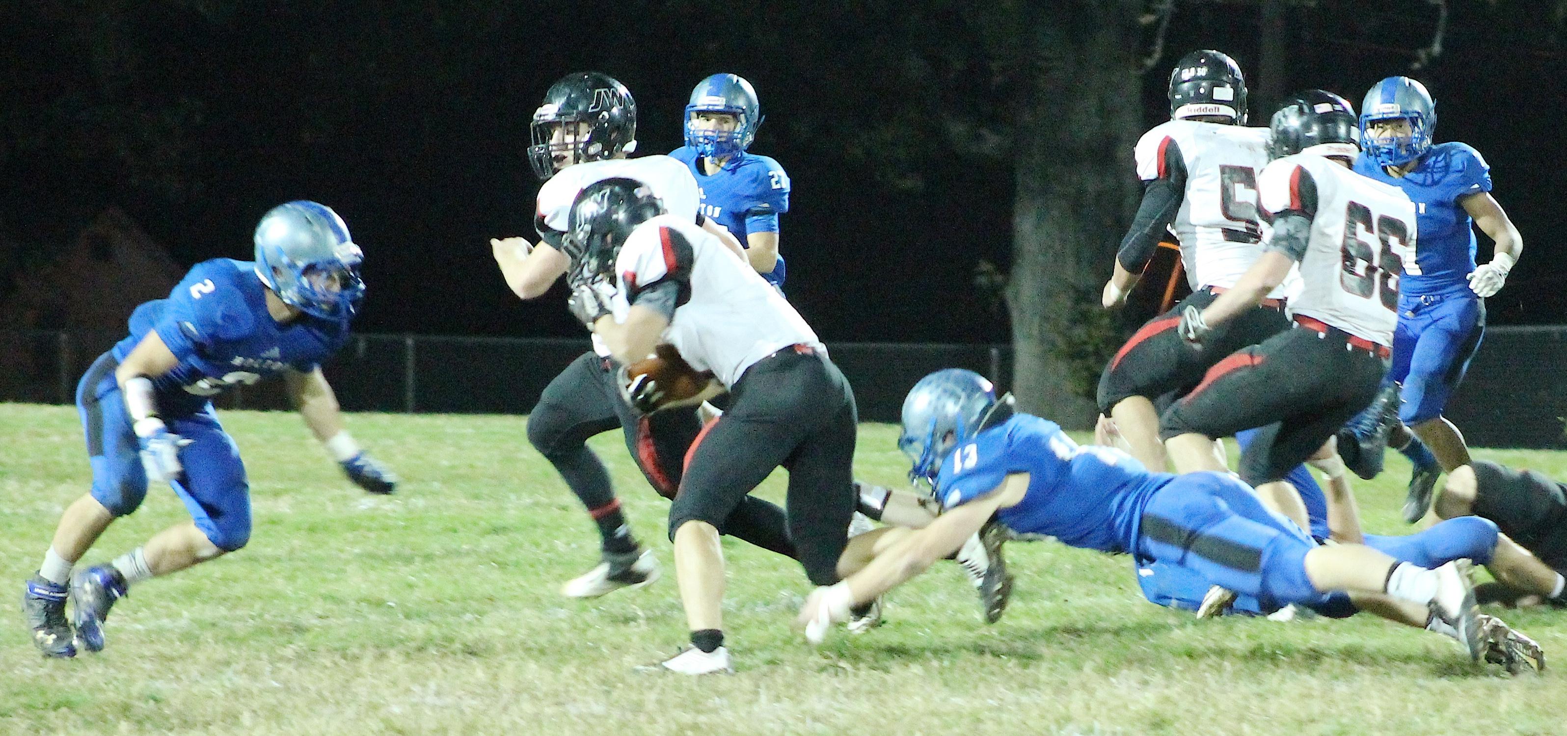 Linebacker Jordan Booth (right) makes a shoestring tackle.