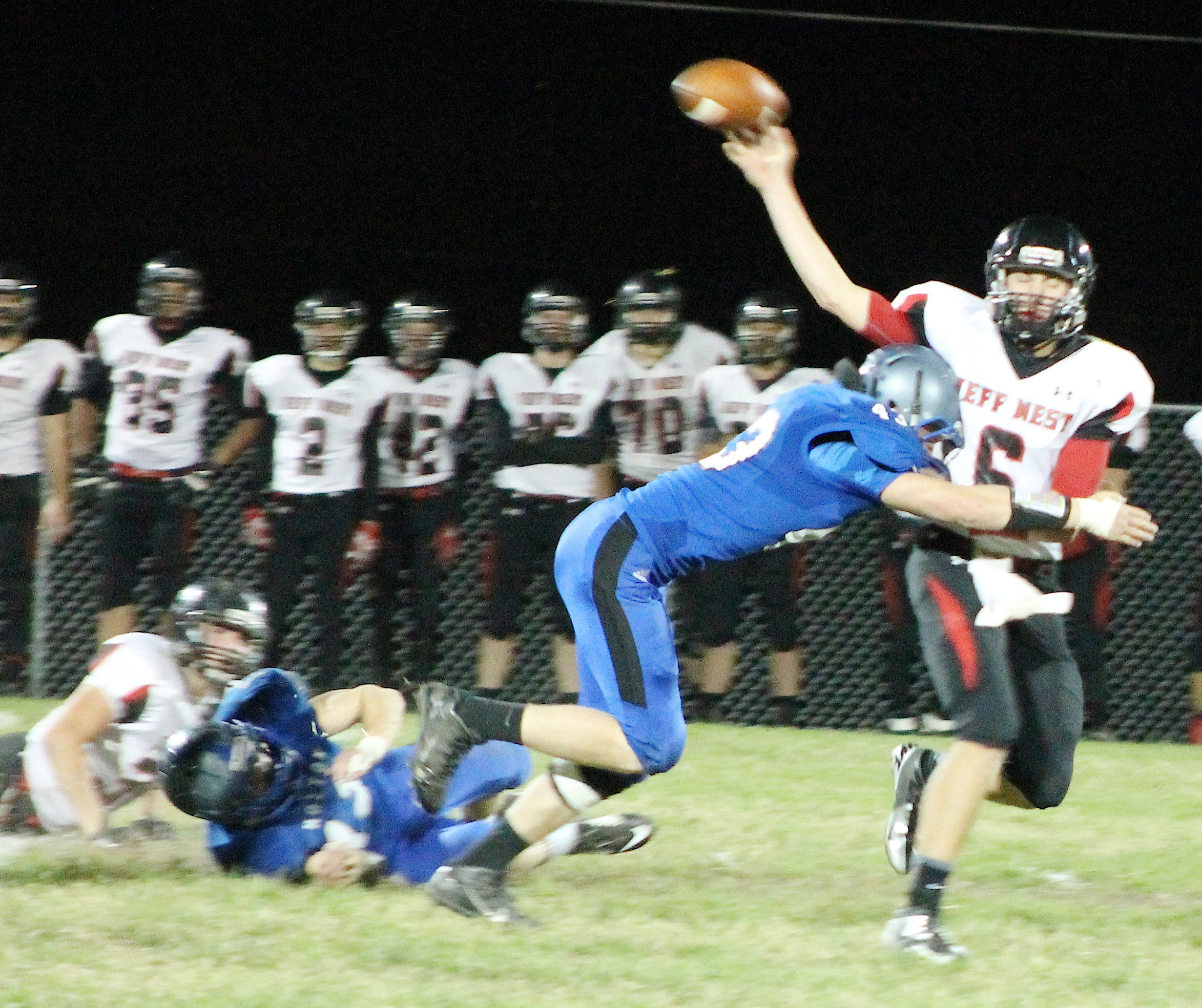 Levi Martin (middle) pressures Jeff West quarterback Jacob Dickey on a crucial play late in the third quarter.