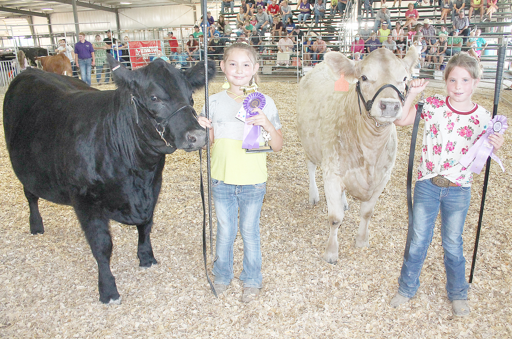 In beginner beef showmanship, Harper Mitchell (left) of the Mayetta Mustangs was named champion while Paisley Askren (right) of the North Jackson Jets was named reserve champion.