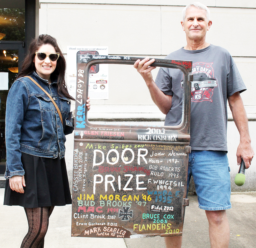 """Tammi Zibell receives the """"door prize"""" from car show organizer Bruce Shaw. More photos to come"""