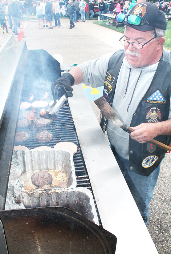 Dale Upton of the Holton Legion Riders grills burgers and brats.
