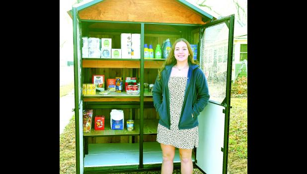 """Olivia Rickel, a sophomore at RVHS, has organized a """"blessing box"""" in front of Hoyt Baptist Church for community members who need groceries or essential items."""