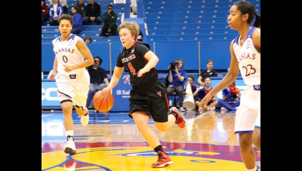 Former Wildcat Ryann Bowser (shown above, middle) pushes the ball up the court in recent Big 12 match-up between Texas Tech and Kansas. Bowser joined the Red Raiders this season after a highly successful run at Highland Community College.