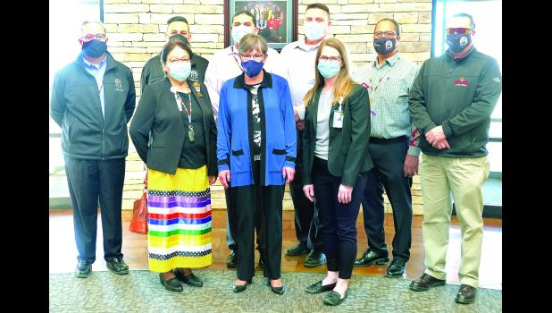 Gov. Laura Kelly (center) recognized the Prairie Band Potawatomi Nation for its efforts to vaccinate members of the Nation and Jackson County residents. Gov. Kelly is shown above with members of the Tribal Council and Kristina Simmons, health center administrator (front row, at right). Tribal council members include Camilla Chouteau (front row, at left) and (back row, from left) Chairman Joseph Rupnick, ZachPahmahmie, William Evans, RaphaelWahwassuck, TonyWahweotten and WadePahmahmie.