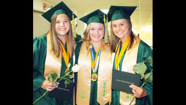 Jackson Heights High School Class of 2020 salutatorian Erin Curtis (left) joined co-valedictorians Jerilyn Nelson (center) and MaKenzie Kennedy to celebrate their graduation. (Photo by Brian Sanders)