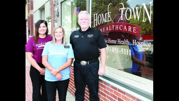 Jon Reed (shown above at right), chief operating officer of Fredonia-based Hometown Health Care, has opened the company's seventh office on the south- west corner of Holton's Town Square. Reed is shown with Hometown Health Care marketing specialists Maria Petersen (left) and Kristi Noonan.