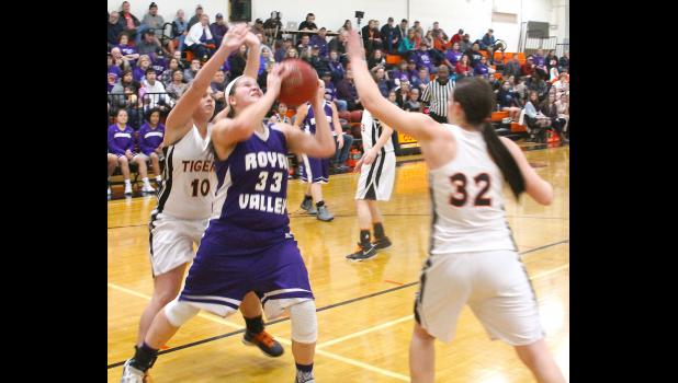 Royal Valley's Kate Hanson (shown above, middle) cuts to the basket late in Tuesday's game at Atchison County. Hanson helped RV close out the 38-20 victory by scoring seven of her 13 points in the fourth period.
