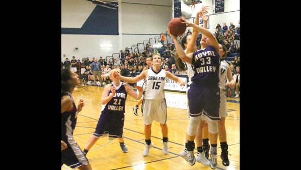 Panther Kate Hanson (shown above, at right) fights for a rebound and goes back up for a basket in a recent contest against the Blue Jays. While Royal Valley led most of the way, the team couldn't quite close out the game and Sabetha stormed back for a victory.