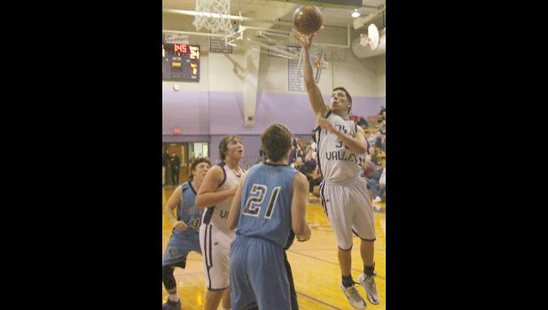 Royal Valley's Tristan Tessendorf (shown above, right) goes up for two of his 10 points in Tuesday's 49-46 victory over visiting Riverside.