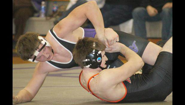 Royal Valley's Jacob Box (shown above, back left) works to get his opponent from ACCHS pinned to the mat late in the match in recent dual competition. Box and the rest of the Panthers have continued to compile some positive results, despite the roster taking hit after hit over the course of the season.