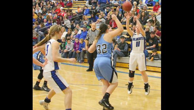 Holton's Taryn Weilert (shown above, at right) pulls up for a jumper in the second half of a game against Riverside last Friday. While defense sparked HHS early, the offense opened up in the second half as Weilert and seemingly every player who entered the game for Holton hit some shots on the way to a 60-26 victory.