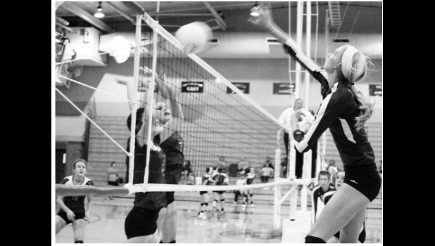 Royal Valley's Hannah Beam (shown above, at right) sends a kill attempt over the net in a league match against Perry-Lecompton on Tuesday night. After smooth sailing early, Beam and the Panthers adjusted in the midst of some adversity and stayed on track to get the sweep over the Kaws.