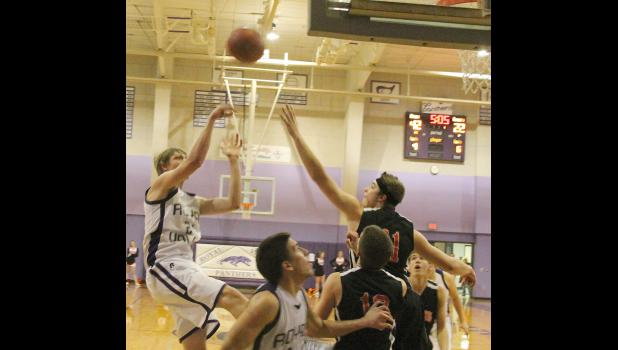 Panther Noah Rottinghaus (shown above, left) falls away after a short jumper in the second half of Tuesday's game at home against the Tigers. Rottinghaus and several of his teammates came alive in the second half and spurred RV to a 51-25 victory.