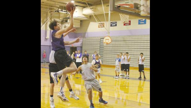 Panther Joe Cullen (shown above, left) slashes to the basket during a drill at a recent RVHS practice focused on transitional offense and defense.