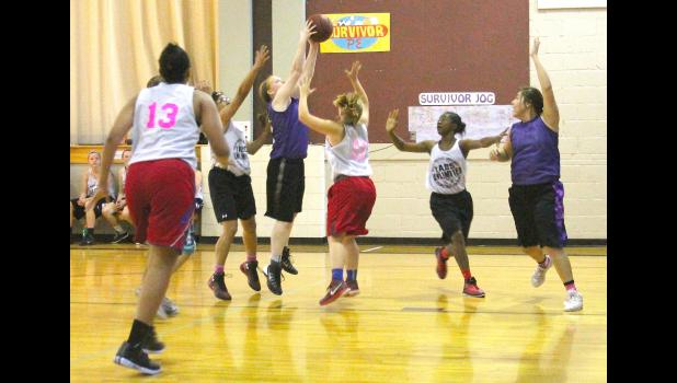 Panther Lexi Baker (shown above, with ball) passes off to teammate Levanna Biggoose on the baseline during summer league action at the RVES gym.