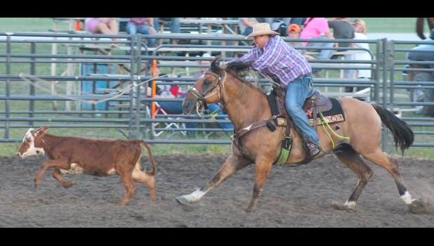 Holton's Jessica Shoemaker (shown above) chases down her calf as part of the breakaway roping competition at the Jackson County Rodeo held this past weekend.
