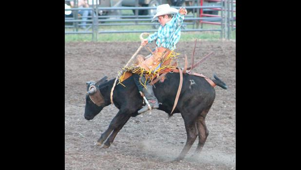 Whiting's Cable Wareham (shown above) competes in the steer riding competition at the Jackson County Rodeo this past Friday, while he also took second in the breakaway roping competition on Saturday. Wareham also competed in the National Junior High Finals Rodeo competition in Iowa earlier this summer.