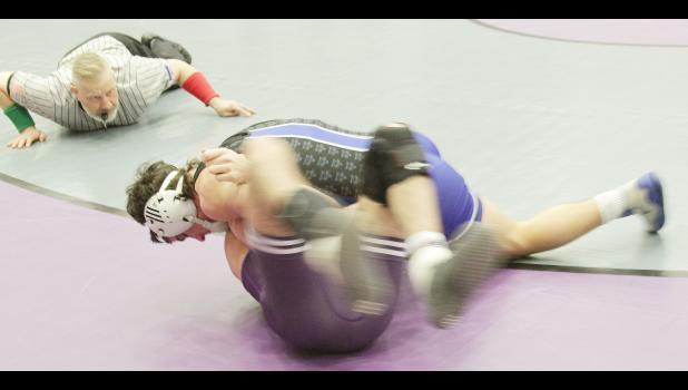 Holton Wildcat Kolby Roush is shown going for a pin at the regional wrestling meet.