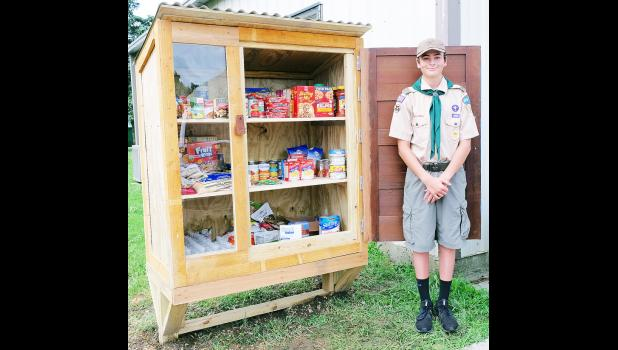 """Caliber Miller has built five """"blessing boxes"""" — including this large one located next to Mayetta City Hall — for his Eagle Scout project. (Photo by Ali Holcomb)"""