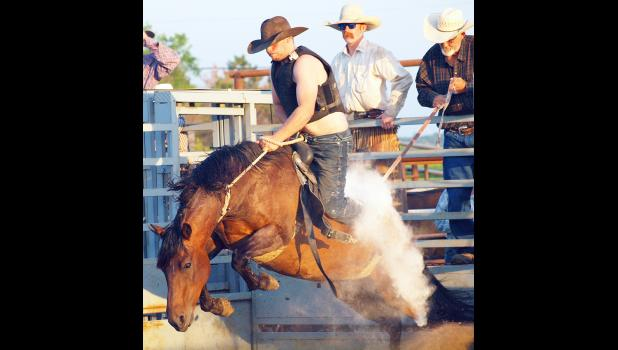 Austin Brokaw of Strawberry Point, Iowa, rode the bronco out of the chute during this past weekend's Jackson County Fair Rodeo, held at the Northeast Kansas Heritage Complex south of Holton. The Heritage Complex will be a hub of activity over the next week, as the 96th-annual Jackson County Fair takes over the grounds. (Photo by Michael Powls)