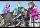 Royal Valley FFA member Wade Collins (second from left) brought his horse, Blackie, to school on Friday as part of the Elementary Agriculture Day program, which is sponsored by the FFA club. Elementary school students getting a closer look at the horse include (from left) Tannah Bailey, Adam Kahle, Madison Blackwood and Amber Mzhickteno. (Photo by Ali Holcomb)