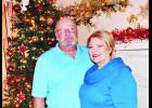 """Phillip and Ginger Lloyd (shown above) are one of five families included on this year's """"I'll Be Home For Christmas"""" homes tour. The Lloyds have an expansive collection of Christmas decor  at their home south of Holton."""