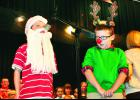 """""""Rudolph, with your nose so bright, won't you guide my sleigh tonight?"""" That was the question that Santa, played by Ethan Peterson (left), asked Rudolph the Red-Nosed Reindeer, played by Logan Heineken, during Thursday's Christmas concert featuring second-grade students from Colorado Elementary School. The concert was held in the Holton High School auditorium."""