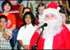 """Santa, played by Mikey Wamego, helped usher in """"A Relaxing Christmas,"""" with help from his elves and reindeer. Third and fourth grade students at Royal Valley held their winter program last week that featured a holiday parade, hip hop turkeys and the rules for Christmas."""