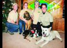 The Kevin and Lisa Smith family of rural Mayetta enjoys training their dogs for search-and-rescue missions in the Jackson County area. From left to right are Kevin, MaRyka, Otis (bloodhound), Karsen, Laudie (border collie), Lisa and Mister (white German shepherd).