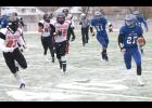 Holton's Justin Pool (shown above, at right) tries to get the outside for a big run in last Saturday's state championship game. Field conditions prevented HHS from making those big plays on offense, while Holcomb got just enough to claim the 4A-DII state title.