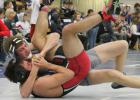 Wildcat Spencer Baum (shown above, back) cradles his opponent in an early round at the Sadowski Invitational tournament this past Saturday in an attempt to get a pin. Baum was one of seven Holton wrestlers to make the finals, helping the team to a second-place finish overall.