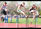 Cobras Logan Wells (shown above, middle) and Kyler Vance (far right) bound over the hurdles in the middle of the 110m race at Tuesday's meet in Holton. Both earned key points that helped the JH boys finish runner-up as a team at the meet.